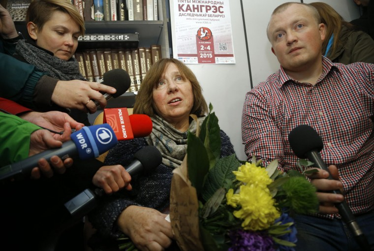 "Belarusian journalist and writer Svetlana Alexievich the 2015 Nobel literature winner, center, is surrounded after her news conference in Minsk, Belarus, Thursday, Oct. 8, 2015. Belarusian writer Svetlana Alexievich won the Nobel Prize in literature Thursday, for works that the prize judges called ""a monument to suffering and courage."" (AP Photo/Sergei Grits)"