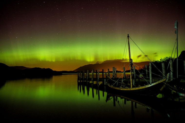 The aurora borealis, or the northern lights occur over Derwentwater, near Keswick, England, Thursday Oct. 8, 2015. The northern lights are the result of collisions between gaseous particles in the Earth's atmosphere with charged particles released from the sun. (Owen Humphreys/PA via AP)