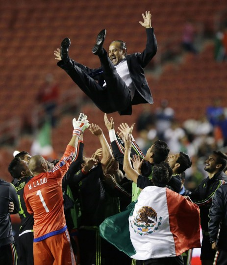 Mexico head coach Raul Gutierrez is thrown in the air by his player following the CONCACAF Menís Olympic qualifying championship match against Honduras, Tuesday, Oct. 13, 2015, in Sandy, Utah. Mexico won 2-0. (AP Photo/Rick Bowmer)