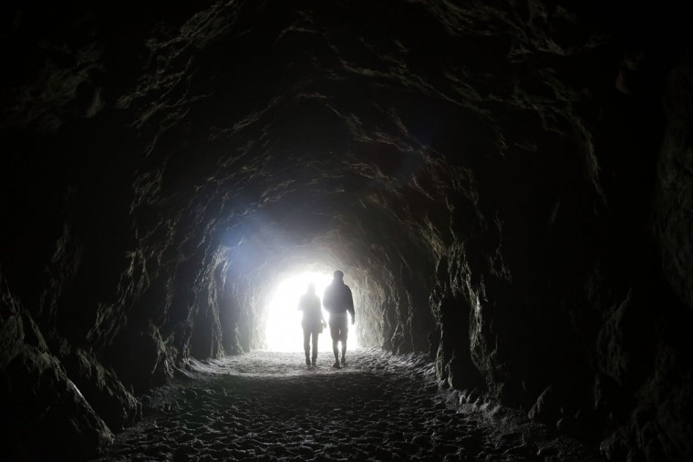 Visitors walk inside a tunnel at Sutro Baths, a popular tourist spot, Tuesday, Oct. 27, 2015, in San Francisco. (AP Photo/Marcio Jose Sanchez)