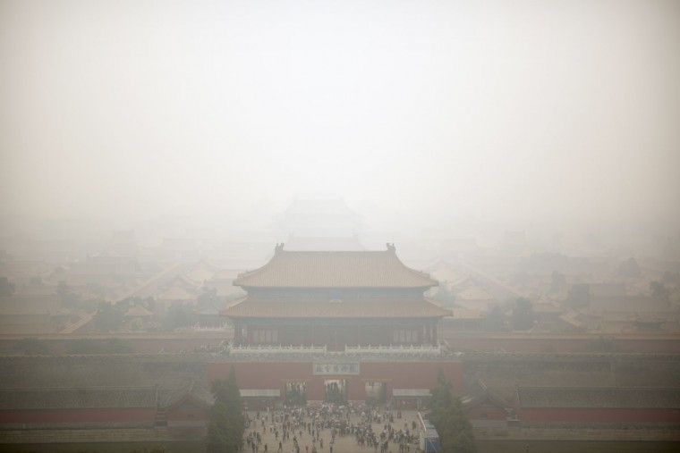 Haze envelops the Forbidden City as seen from nearby hilltop park on a polluted day in Beijing, Wednesday, Oct. 7, 2015. Wednesday is the last day of China's weeklong National Day holiday, traditionally a peak time of the year for tourist travel, but for the second day in a row air quality readings in Chinese capital were at levels considered hazardous by international measuring standards. (AP Photo/Mark Schiefelbein)