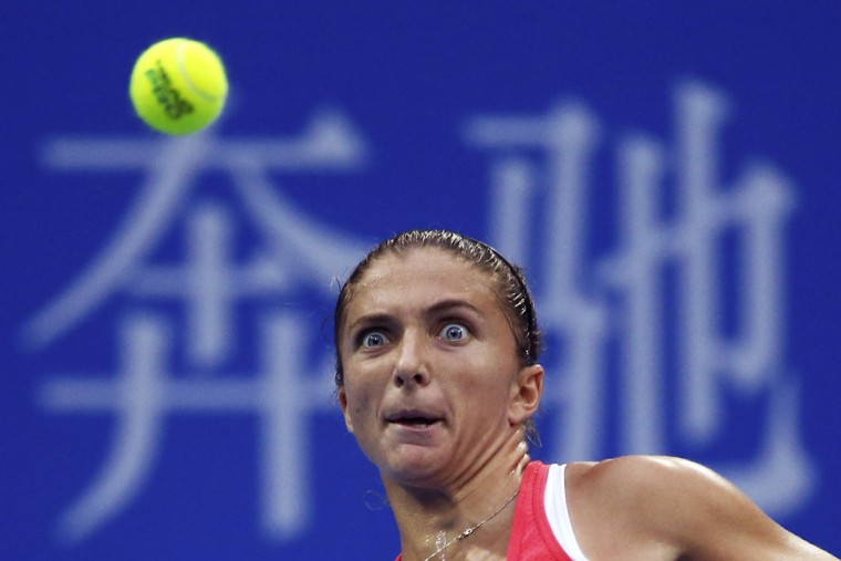 Sara Errani of Italy eyes on the ball as she plays against Andrea Petkovic of Germany during their third round women's singles match of the China Open tennis tournament at the National Tennis Stadium in Beijing, Wednesday, Oct. 7, 2015. (AP Photo/Andy Wong)