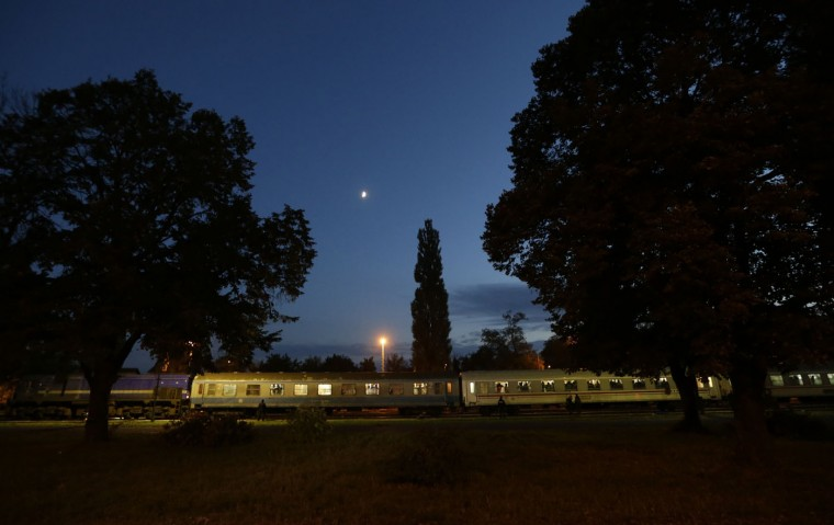 A train carrying hundreds of migrants stops at the train station in Cakovec, Croatia, Tuesday, Oct. 20, 2015. Hungary shut down its border with Croatia to the free flow of migrants, prompting Croatia to redirect thousands of people toward its border with Slovenia. (AP Photo/Petr David Josek)