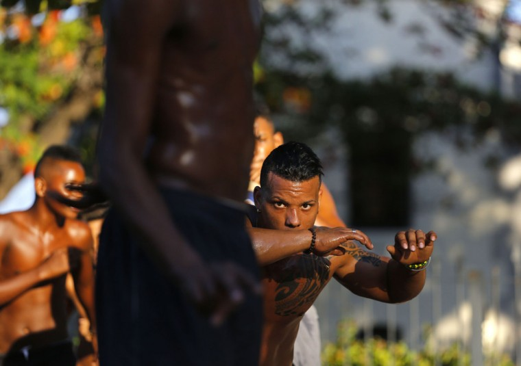 Youths attend a Capoeira lesson on a street in Havana, Cuba, Monday, Oct. 5, 2015. Capoeira is a 400-year-old martial art disguised as dance, created by African slaves in Salvador da Bahia, Brazilís first capital. (AP Photo/Desmond Boylan)