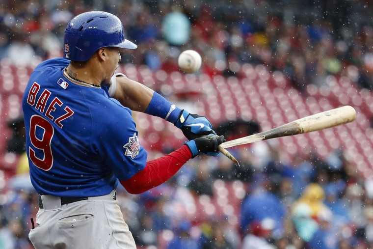 Chicago Cubs' Javier Baez breaks his bat on a foul tip off Cincinnati Reds starting pitcher John Lamb in the fifth inning of a baseball game, Thursday, Oct. 1, 2015, in Cincinnati. (AP Photo/John Minchillo)