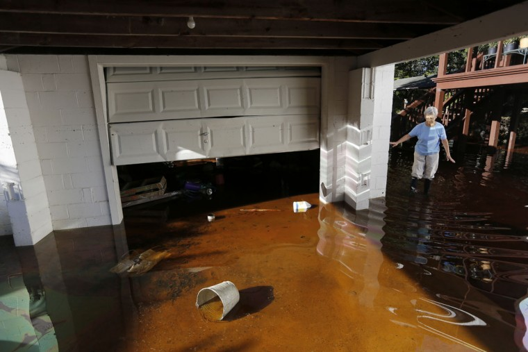 Roberta Albers walks around her home after the floodwaters start to recede at French Quarter Creek in Huger, S.C., Wednesday, Oct. 7, 2015. French Quarter Creek is prone to flooding, but all residents who have lived there for several decades say this is the worst it has ever been. (AP Photo/Mic Smith)