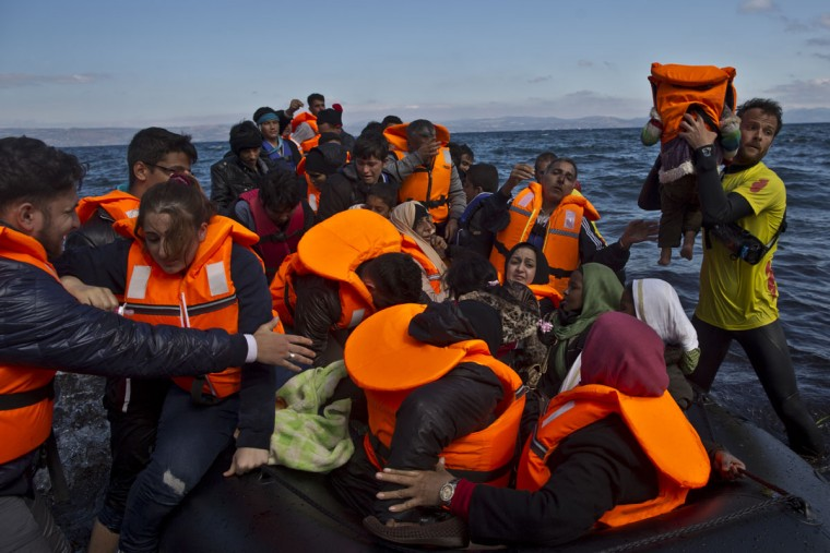 Refugees arrive on a dinghy from the Turkish coast to the northeastern Greek island of Lesbos, Thursday, Oct. 1, 2015. The International Organization for Migration says a record number of people have crossed the Mediterranean into Europe this year, now topping a half a million as some 388,000 have entered via Greece. (AP Photo/Muhammed Muheisen)
