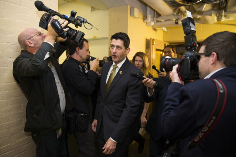 Rep. Paul Ryan, R-Wis., is surrounded by media as he arrives for a House GOP conference meeting in Capitol Hill in Washington, Wednesday, Oct. 21, 2015. Ryan is seeking unity in a place it's rarely found, telling House Republicans he will serve as their speaker only if they embrace him by week's end as their consensus candidate. (AP Photo/Evan Vucci)