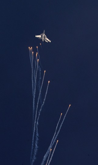 Indian Air Force Sukhoi Su-30 MKI fires flares during a Vertical Charlie maneuver at the Air Force Day parade at Hindon Air Force base near New Delhi, India, Thursday, Oct. 8, 2015. Air Chief Marshal Arup Raha announced Thursday that the IAF would have women fighter pilots, a proposal pending at the Indian Defense Ministry for approval. (AP Photo/Manish Swarup)