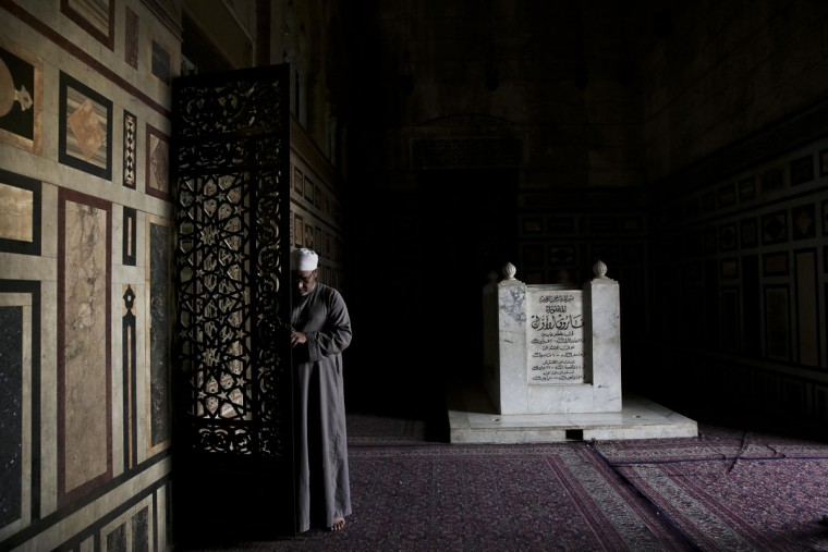A man opens the doors of Egypt's late King Farouk's tomb, at the Al-Rifa'i Mosque in Cairo, Egypt, Wednesday, Oct. 7, 2015. The mosque is filled with numerous tombs of Egypt's late royal family and Iran's late Shah Mohammed Riza Pahlevi. (AP Photo/Nariman El-Mofty)