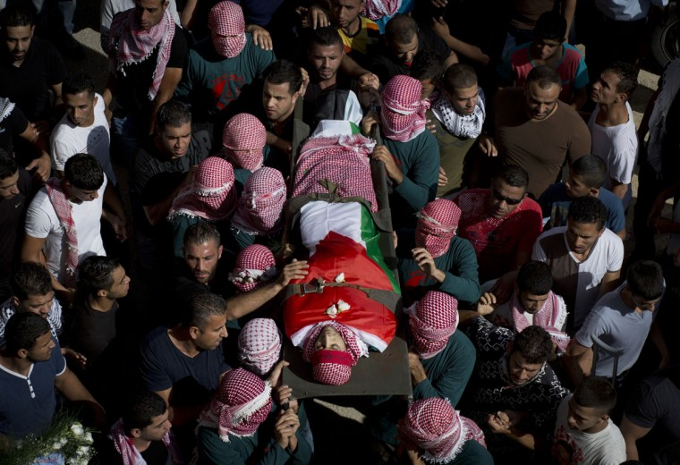 Palestinian mourners carry the body of Moataz Zawahara, who was killed in clashes with Israeli troops, during his funeral in Deheisha refugee camp, near the West Bank city of Bethlehem, Wednesday, Oct. 14, 2015. (AP Photo/Nasser Nasser)