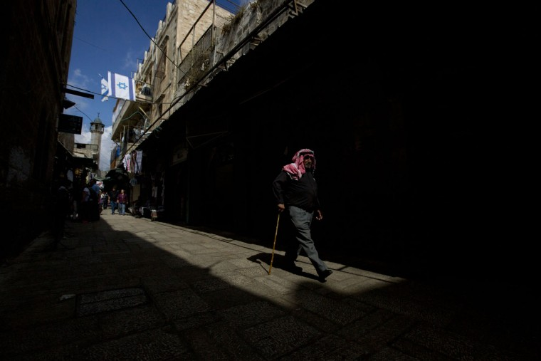 A Palestinian man walks in the old city in Jerusalem, Thursday, Oct. 8, 2015. A Palestinian stabbed a Jewish seminary student in Jerusalem on Thursday as the Israeli prime minister barred all Cabinet ministers and lawmakers from visiting a sensitive holy site in the Old City in an effort to calm tensions that have gripped the country for weeks. (AP Photo/Sebastian Scheiner)