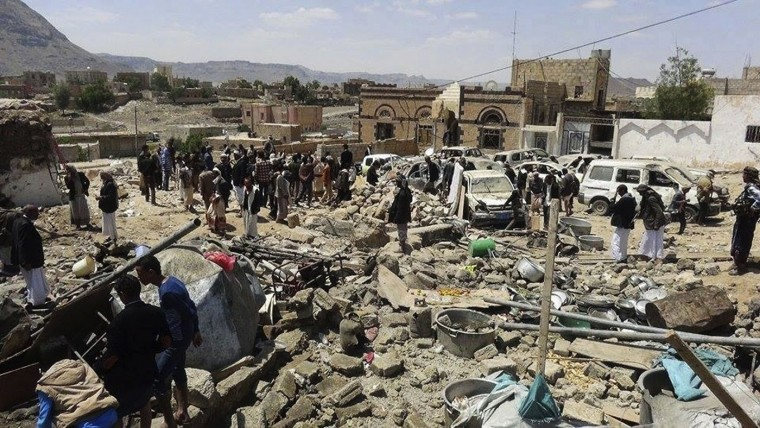 People gather at the site of Saudi-led airstrikes in Sanban, a region in Dhamar province 113 km (70 miles) southeast of the capital, Sanaa, Yemen, Thursday, Oct. 8, 2015. Two airstrikes by the Saudi-led coalition killed at least 15 civilians and wounded 25 others in Yemen on Wednesday at a wedding hosted by a tribal leader known to support the Houthi rebels, witnesses and independent security officials said. (AP Photo/Ali al-Hassany)