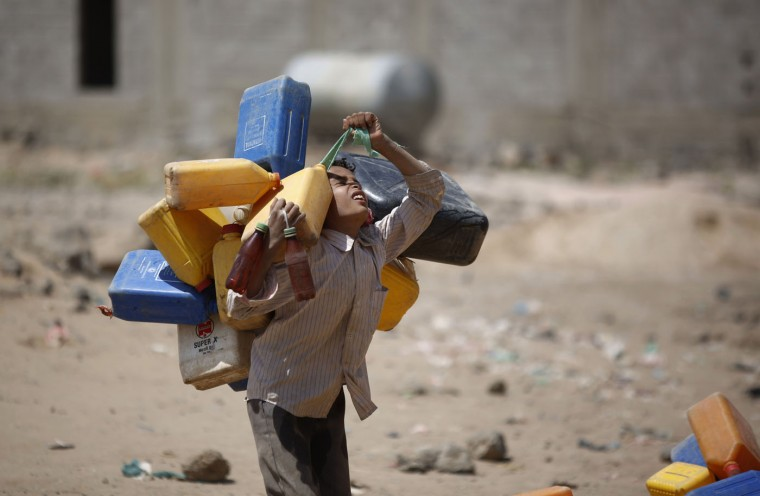 A boy carries buckets to fill with water from a public tap amid an acute shortage of water, on the outskirts of Sanaa, Yemen, Tuesday, Oct. 13, 2015. The war has taken a heavy toll on Yemen. More than 4,000 people have been killed, and the humanitarian crisis has left the impoverished country on the brink of famine. (AP Photo/Hani Mohammed)