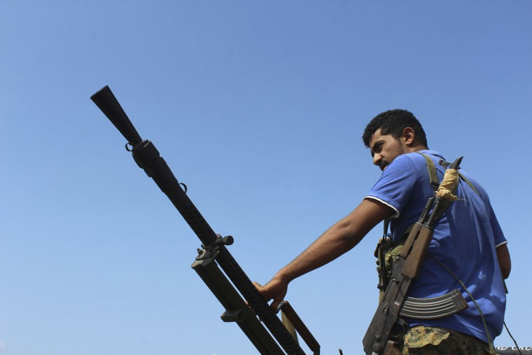 A fighter against Shiite rebels known as Houthis holds a weapon on a road leading to the strategic strait of Bab al-Mandab off Aden, Yemen, Thursday, Oct. 1, 2015. Military and security officials said fierce battles are ongoing between military units loyal to Yemeni President Abed Rabbo Mansour Hadi and pro-Hadi fighters against Shiite Houthi rebels and allied military units in Bab al-Mandab, the strategic southern entrance to the Red Sea. (AP Photo/Wael Qubady)