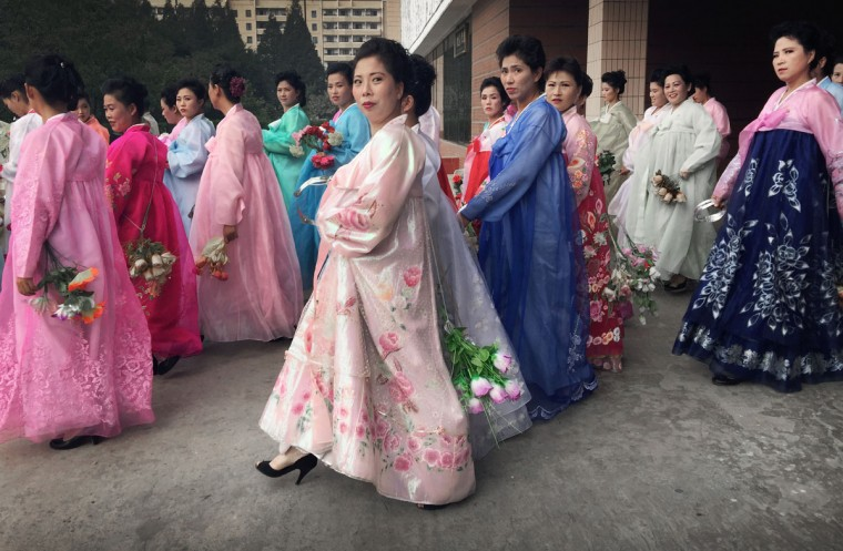 North Korean women wearing traditional dresses gather for rehearsals, Wednesday, Oct. 7, 2015, in Pyongyang, North Korea in preparation for the 70th anniversary of the founding of their country's ruling party on Oct. 10, 2015. (AP Photo/Wong Maye-E)