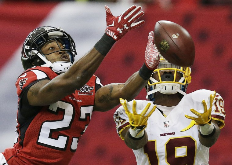 Washington Redskins wide receiver Rashad Ross (19) tries to make the catch as Atlanta Falcons cornerback Robert Alford (23) defends during the second half of an NFL football game, Sunday, Oct. 11, 2015, in Atlanta. (AP Photo/Brynn Anderson)