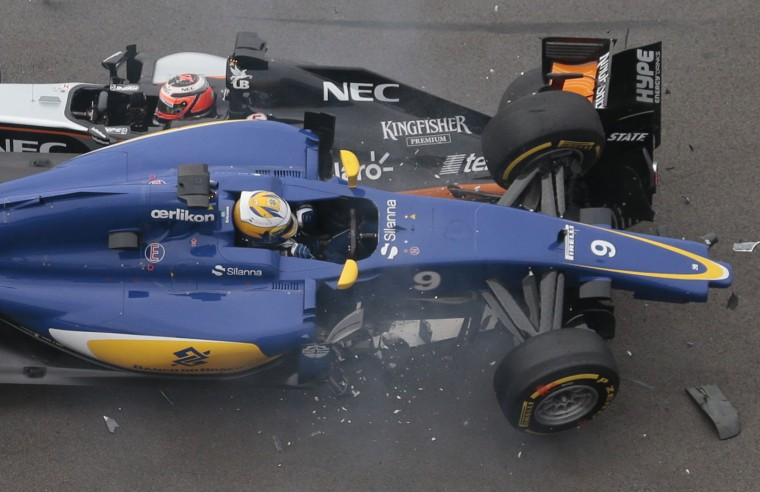 Force India driver Nico Hulkenberg of Germany, top, and Sauber driver Marcus Ericsson of Sweden collide during the Formula One Russian Grand Prix at the 'Sochi Autodrom' Formula One circuit in Sochi, Russia, on Sunday, Oct. 11, 2015. (AP Photo/Ivan Sekretarev)
