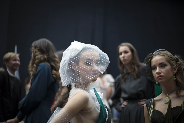 Models wait backstage, during Fashion Week in Moscow, Russia, Thursday, Oct. 15, 2015. (AP Photo/Alexander Zemlianichenko)