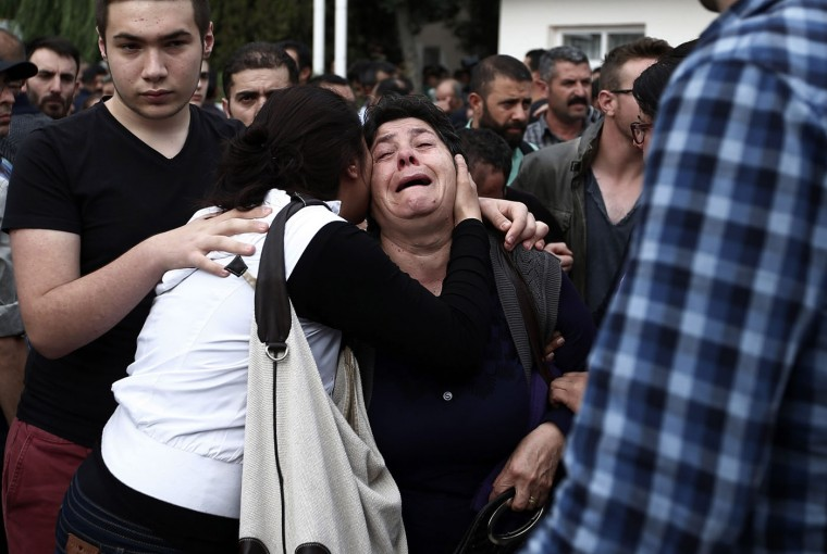 People react after Saturday's bombing attacks, outside a hospital's morgue, in Ankara, Turkey, Sunday, Oct. 11, 2015. Turkey declared three days of mourning following Saturday's nearly simultaneous explosions that targeted a peace rally in Ankara to call for increased democracy and an end to the renewed fighting between the Turkish security forces and Kurdish rebels. (AP Photo/Emrah Gurel)