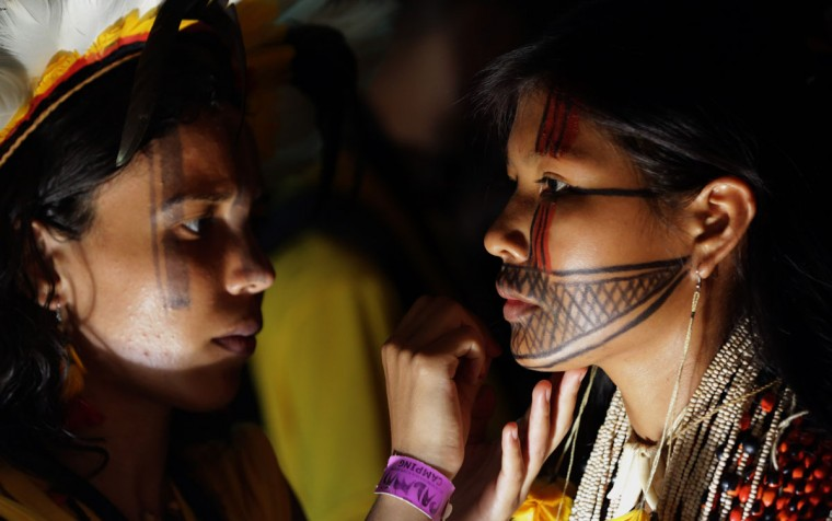In this photo taken Saturday, Oct. 24, 2015, Brazilians prepare for a indigenous beauty parade during World Indigenous Games, in Palmas, Brazil. (AP Photo/Eraldo Peres)