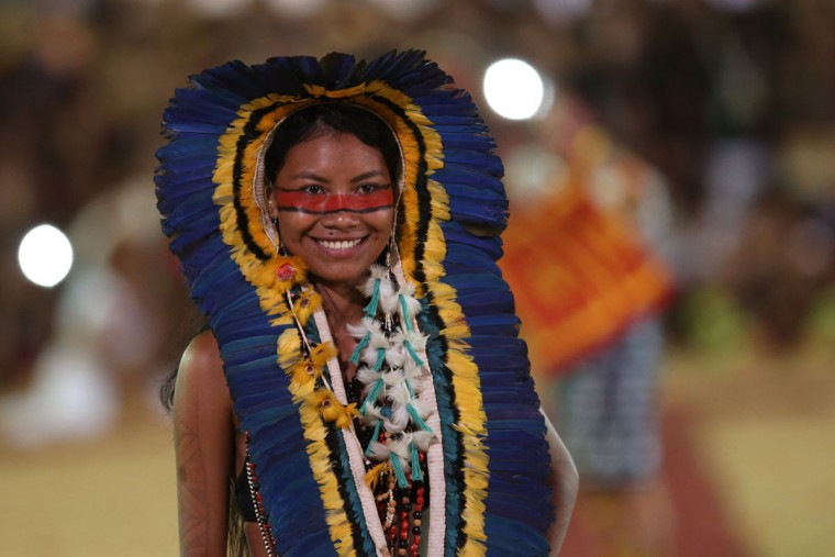 In this photo taken Saturday, Oct. 24, 2015 a Brazilian woman from the Manoki ethnic group takes part in the parade of indigenous beauty at the World Indigenous Games, in Palmas, Brazil, Saturday, Oct. 24, 2015. (AP Photo/Eraldo Peres)