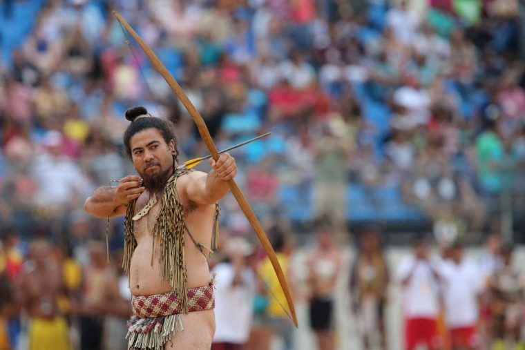 A New Zealand Maori takes part in the bow and arrow competition, at the World Indigenous Games, in Palmas, Brazil, Sunday, Oct. 25, 2015. (AP Photo/Eraldo Peres)