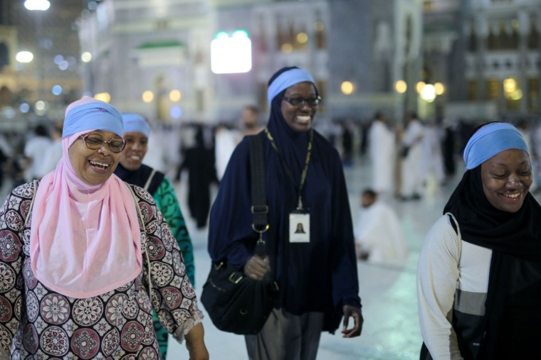 American Muslims Zainab Nasir, left, Shahidah Sharif, Jamila Rashid, second left, and an unidentified friend walk outside the grand mosque on their way to circle the Kaaba, the cubic building at the Grand Mosque in the Muslim holy city of Mecca, Saudi Arabia. For American black Muslims, this year brought a significant landmark, the 50th anniversary of Malcolm Xís death. A year before his assassination, Malcolm X underwent a transformative experience on hajj, seeing the potential for racial co-existence after witnessing, as he wrote, pilgrims ìof all colors displaying a spirit of unity and brotherhood.î (AP Photo/Mosa'ab Elshamy)