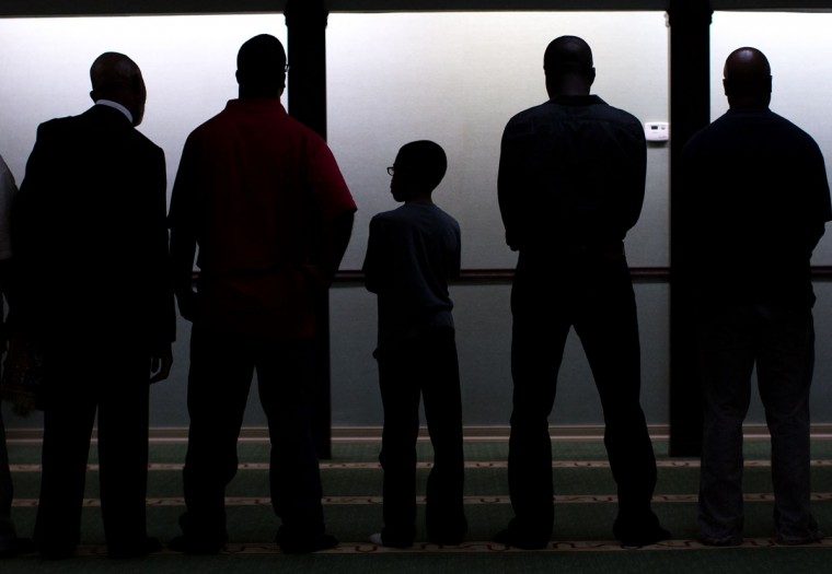 Muslim men pray together during Sunday prayers at the Atlanta Masjid of Al Islam mosque, Aug. 30, 2015, in Atlanta. Members of the mosque gathered to celebrate a group of pilgrims who will make the annual Hajj pilgrimage to the holy city of Mecca. (AP Photo/Branden Camp)