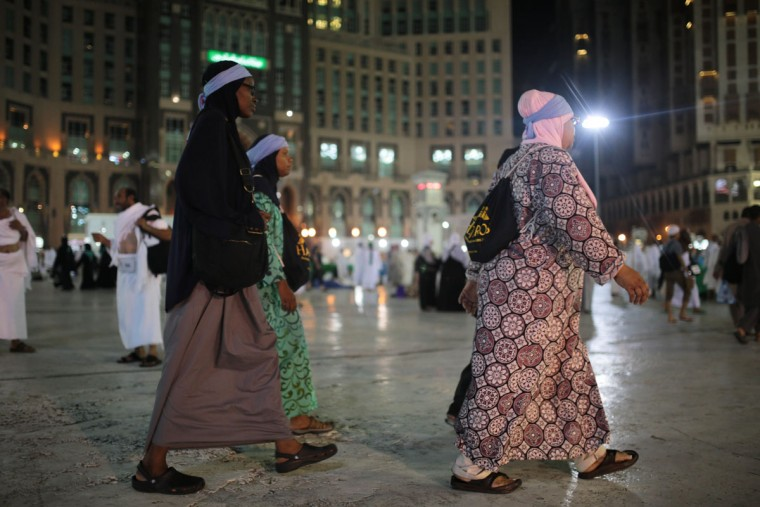 American Muslim women walk outside the grand mosque on their way to circle the Kaaba, the cubic building at the Grand Mosque in the Muslim holy city of Mecca, Saudi Arabia. (AP Photo/Mosa'ab Elshamy)