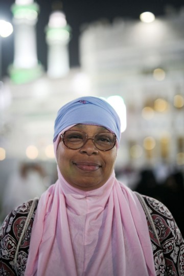 Zainab Nasir, 59, from Oakland, Calif., poses for a picture outside the Grand mosque in the holy city of Mecca, Saudi Arabia. Nasir has six sons and a daughter. One of her older sons, Yusuf, is with her on the hajj. (AP Photo/Mosa'ab Elshamy)