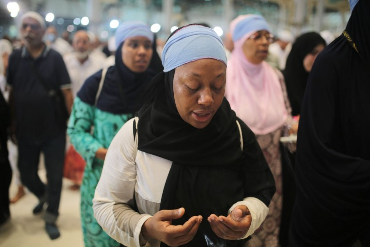 Shahidah Sharif circles the Kaaba, the cubic building at the Grand Mosque in the Muslim holy city of Mecca, Saudi Arabia. As Sharif, an African-American Muslim, joined millions of fellow pilgrims from around the world on the hajj this year, she felt a renewed connection. To her own ìblackness,î she says, but also to humanity as a whole. (AP Photo/Mosa'ab Elshamy)