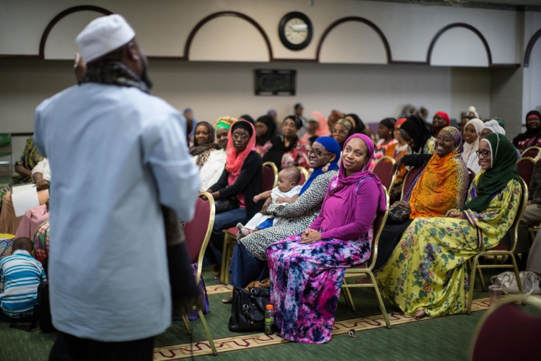 Imam Suleimaan Hamed, left, speaks to members of the Atlanta Masjid of Al Islam mosque in Atlanta. Members of the mosque gathered to celebrate a group of pilgrims who will make the annual Hajj pilgrimage to the holy city of Mecca. (AP Photo/Branden Camp)