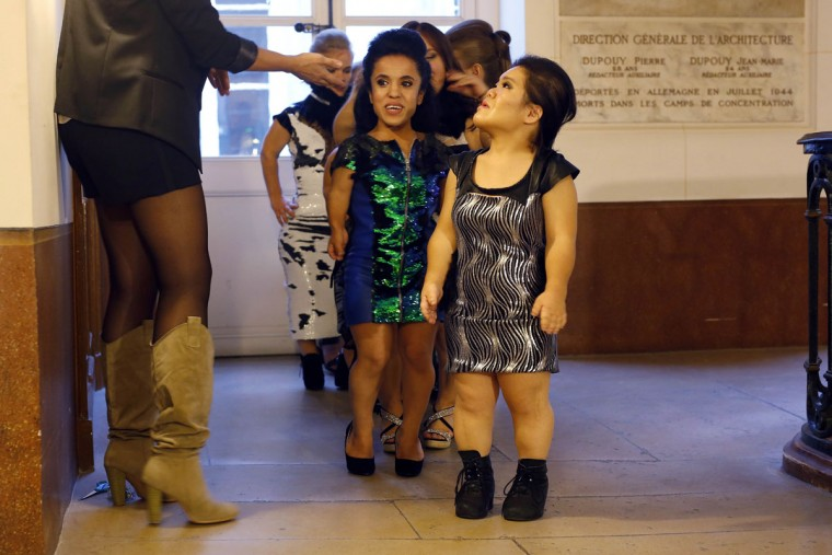 Models get lined-up before hitting the catwalk at the French Ministry of Culture during the dwarf fashion show in Paris, France, Friday Oct. 2, 2015. The dwarf fashion show is an event organizers say is aimed at highlighting the elitism and prejudice that the model industry encourages in its depiction of bodies. It is presented during the Paris Fashion Week but is not part of it. (AP Photo/Jerome Delay)