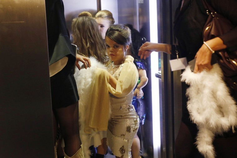 Models get in an elevator moments before hitting the catwalk at the French Ministry of Culture during the dwarf fashion show in Paris, France, Friday Oct. 2, 2015. The show is an event organizers say is aimed at highlighting the elitism and prejudice that the model industry encourages in its depiction of bodies. It is presented during the Paris Fashion Week but is not part of it. (AP Photo/Jerome Delay)