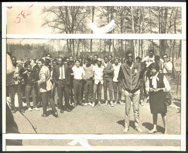 March 31, 1968 - BLOCKADE -- Roland R. Smith, Jr. Bowie State College student government president, and Cora Rice, an N.A.A.P. official, stand before a student barrier in front of school. (George H. Cook/Baltimore Sun)