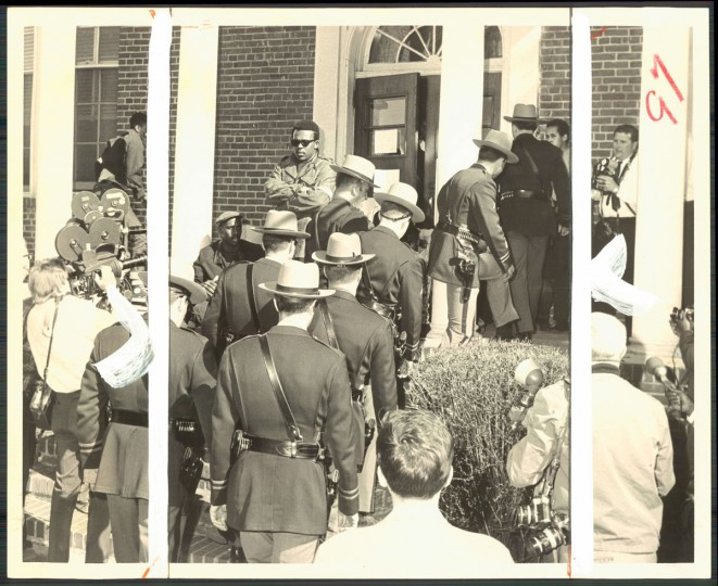 Eight State troopers file through students into the administration building of Bowie State College during mid-afternoon. (Hotz/Baltimore Sun, 1968)