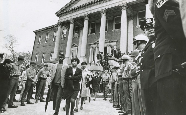 "State Troopers guard the steps up to the Governor's office in the State House as students conducted a ""study-in"" to protest Governor Agnew's refusal to meet them. When they ignored the Trooper's orders to clear the building, they were arrested, marched peacefully to busses and jailed. (William L. LaForce/Baltimore Sun, 1968)"