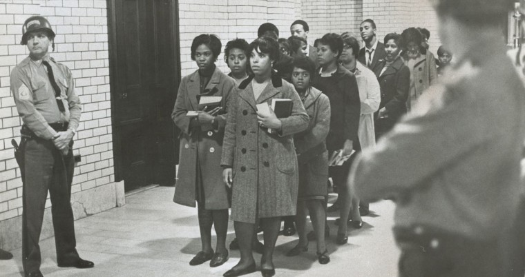 Awaiting Jail - Bowie State College students, arrested for refusing to leave the State House, wait quietly in the Capital basement for transportation to the county detention center. (Paul Hutchins/Baltimore Sun, 1968)