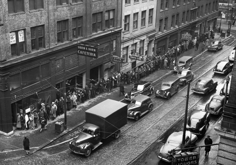 1945 - The cigarette line at Guilford and Fayette Streets line extending to Baltimore Sun. (A. Aubrey Bodine/Baltimore Sun)