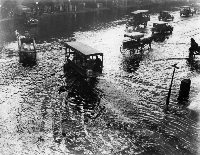1942 - Light Street at Pratt as it looked during a flood in 1942. In the background is the Ericsson Line's pier. (A. Aubrey Bodine/Baltimore Sun)