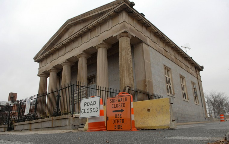 Northbound Aisquith Street is closed between E. Baltimore and Fayette streets, and as a result a reader says that drivers sometimes drive the wrong way on the southbound lanes to reach Fayette Street. Building pictured is the McKim Free School. (Baltimore Sun photo by Glenn Fawcett, Dec. 16, 2008)