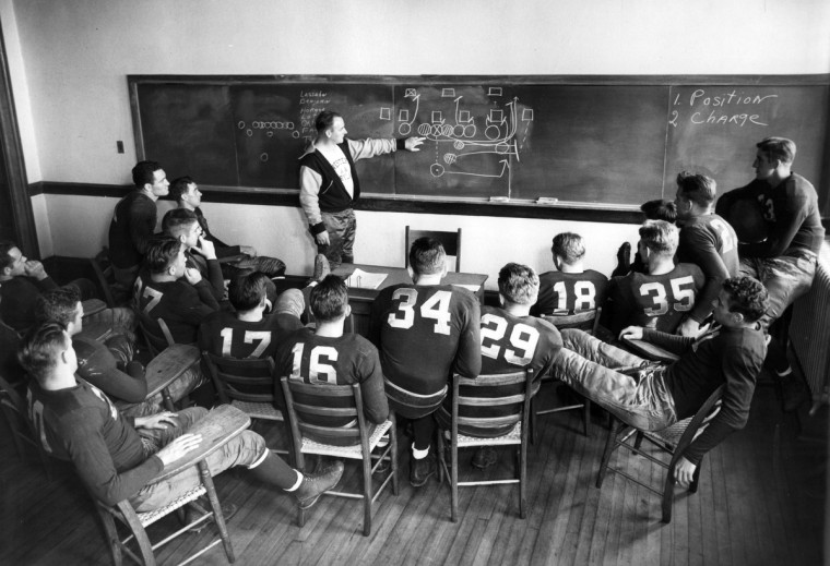 1936 - Head Coach Charley Havens is shown conducting a skill session for members of Western Maryland's Green Terrors squad. The Terror coach is pointing out an off tackle play. (A. Aubrey Bodine/Baltimore Sun)