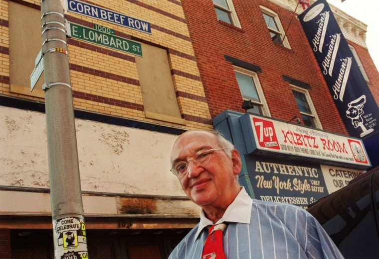 Attman's Deli owner Seymour Attman is pictured by the Corn Beef Row street sign. (Baltimore Sun photo by Jed Kirschbaum, Nov. 1, 2001)