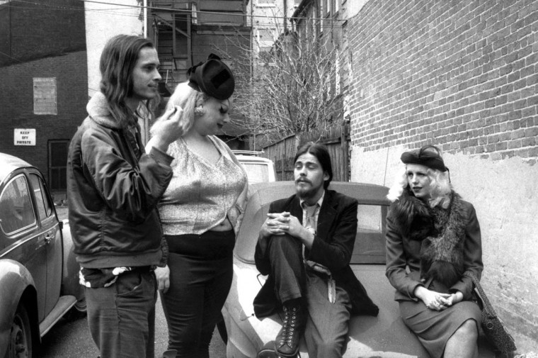 """Waitin' on Nazzi"": John Waters, Divine, Danny Mills, Mary Vivian Pearce (LtoR) wait for Nazzi the dog to take the most famous crap in cinematic history. Jan., 1972. From the documentary film ""Divine Trash."" (Steve Yeager/Handout)"