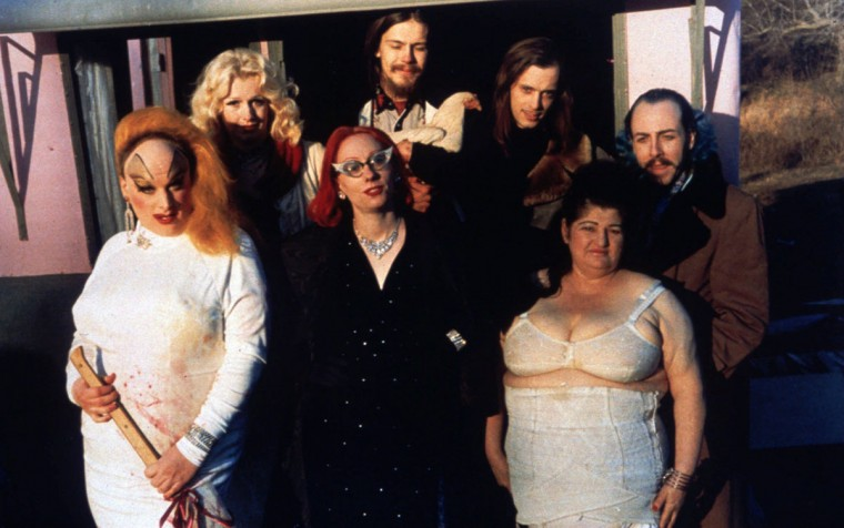 "The cast of ""Pink Flamingos."" Front row, left to right: Divine/Babs Johnson (Divine), Connie Marble (Mink Stole), and Mama Edie (Edith Massey). Back row, left to Tight: Cotton (Mary Vivian Pearce), Crackers (Danny Mills), writer/director John Waters, and Raymond Marble (David Lochary). (Lawrence Irvine/Fine Line Features)"