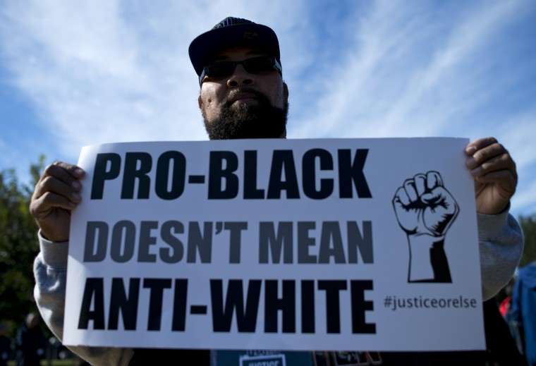 A protester holds up a sign during the Justice or Else! rally on the National Mall in Washington, DC on October 10, 2015. The rally commemorates the 20th anniversary of the Million Man March which took place on October 16, 1995. (Andrew Caballero-Reynolds/AFP-Getty Images)