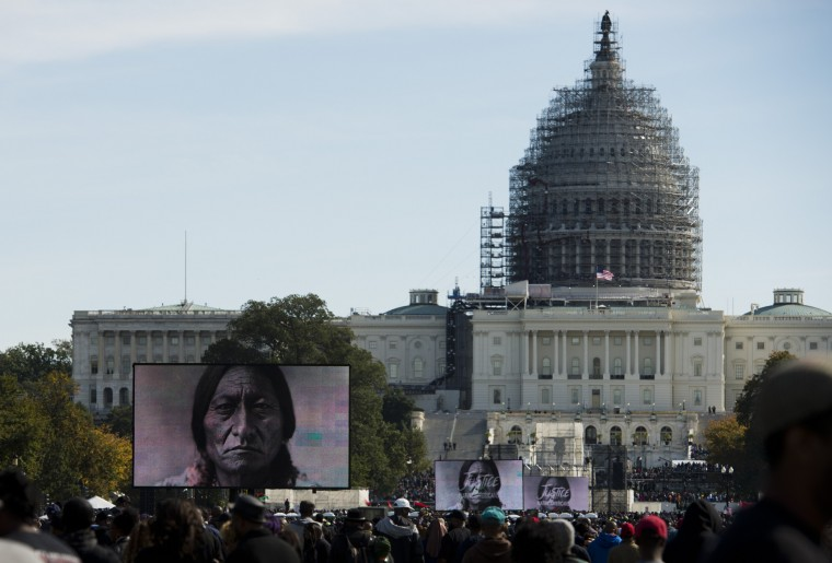 People listen to speeches during the Justice or Else! rally on the National Mall in Washington, DC on October 10, 2015. The rally commemorates the 20th anniversary of the Million Man March which took place on October 16, 1995. (Andrew Caballero-Reynolds/AFP-Getty Images)