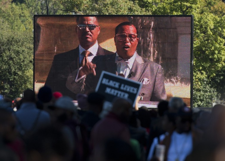 The Nation of Islam leader, Louis Farrakhan, is projected on a screen as he speaks during the Justice or Else! rally on the National Mall in Washington, DC on October 10, 2015. The rally commemorates the 20th anniversary of the Million Man March which took place on October 16, 1995. (Andrew Caballero-Reynolds/AFP-Getty Images)
