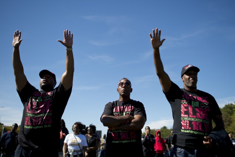 Men listen to speeches during the Justice or Else! rally on the National Mall in Washington, DC on October 10, 2015. The rally commemorates the 20th anniversary of the Million Man March which took place on October 16, 1995. (Andrew Caballero-Reynolds/AFP-Getty Images)